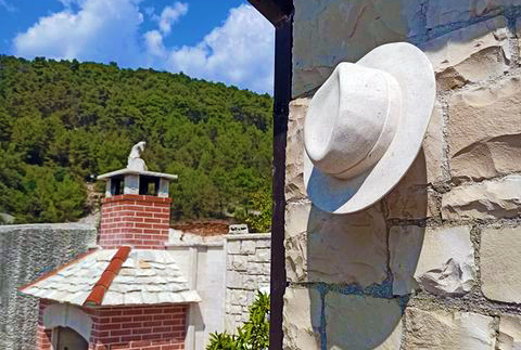 Stone sculpture of a hat